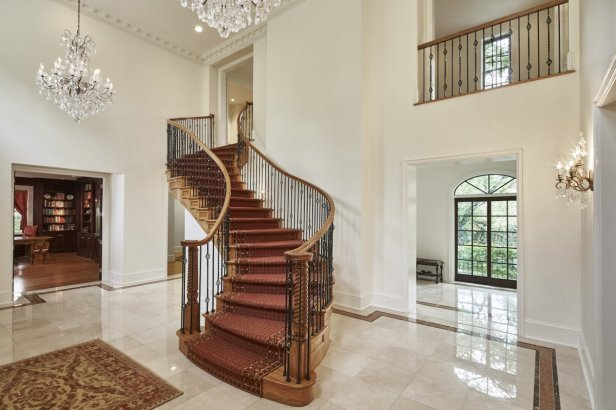 the-s-shaped-staircase-marble-floors-and-chandeliers-make-for-a-dramatic-entrance